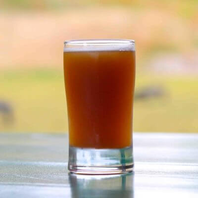glass of beer on a picnic table